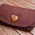 brown linen fabric clutch bag with olive wood heart and hand embroidered heart motif