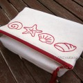 foldover cotton clutch with embroidered sea shells