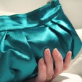 sea-breeze-turquoise-clutch-bag-in-the-hand