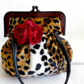 velvet handbag with leopard pattern folds