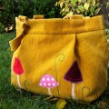 yellow-upcycled-corduroy-bag-in-the-garden
